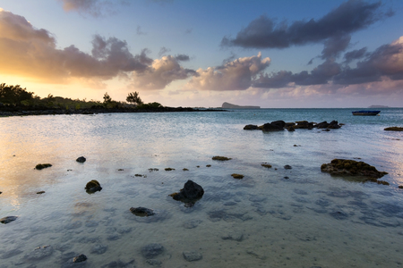 Sunset at beach making a beautiful transition of orange to blue Stock Photo - 102165610