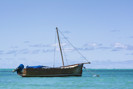 Mauritian traditional boat floating in Ocean Stock Photo