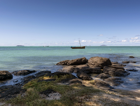 Mauritian traditional boat floating in Turquoise Ocean Stock Photo