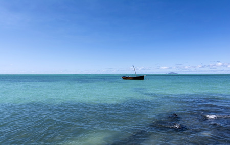 Mauritian traditional boat floating in Turquoise Ocean Stock Photo - 102151135