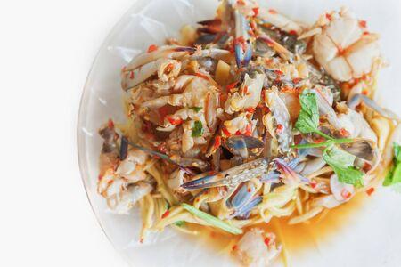 Papaya salad and fresh blue crab in dish , Thai food Stock Photo