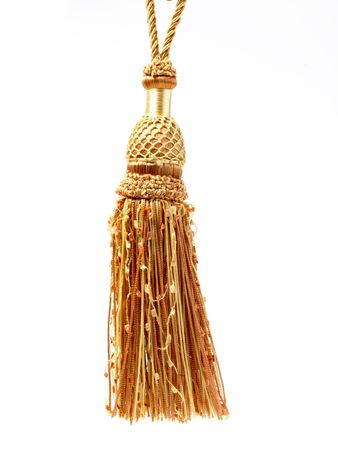 yellow tassel: Yellow color tassel hanging in white background