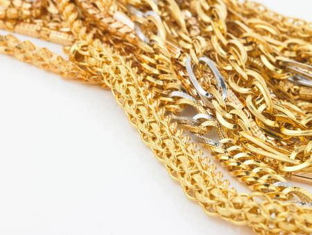 Lots of gold chains on white background