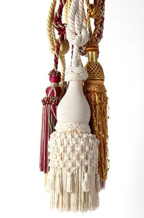 Multi color tassels HANGING in white background photo