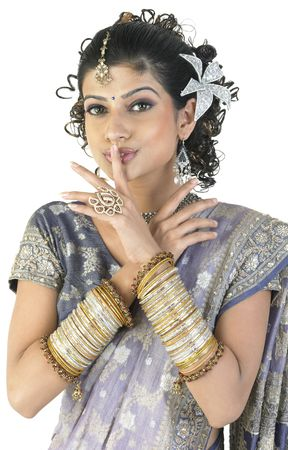 girl saying silent with hand full of beautiful bangles Stock Photo - 4638235