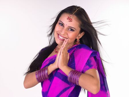 Laughing Young girl with sari in a welcoming posture Stock Photo - 4629323