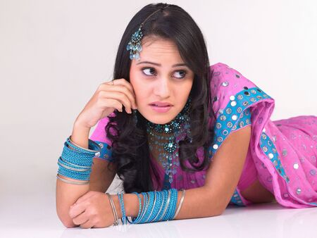 Indian girl in a thinking expression photo