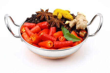 bowl of red chilli with anise ginger and turmeric photo