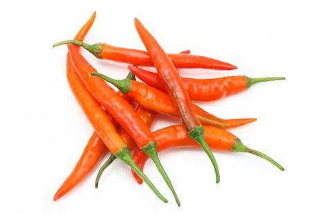 intense flavor: Orange chilies Stock Photo