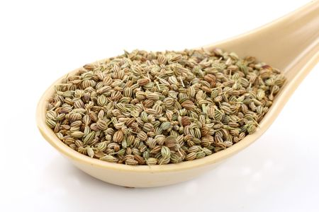 Spoon of ajwain seeds on white background Stock Photo