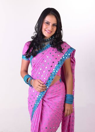 Gorgeous girl with pink sari in a standing posture Stock Photo