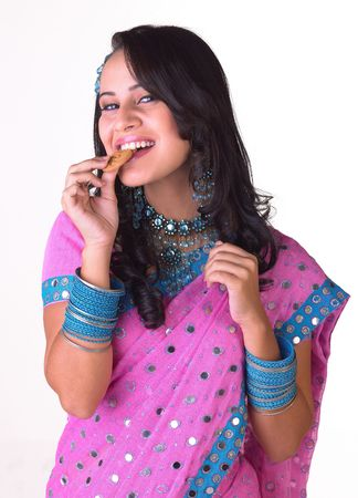 Girl with pink sari eating the biscuit Stock Photo - 4644578