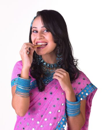 sexy food: Charming indian model biting the biscuit