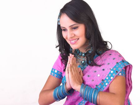 Indian girl with welcoming pose photo