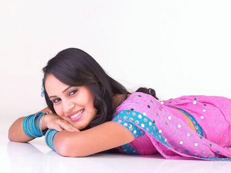 Asian girl with beautiful smile lying on the floor photo