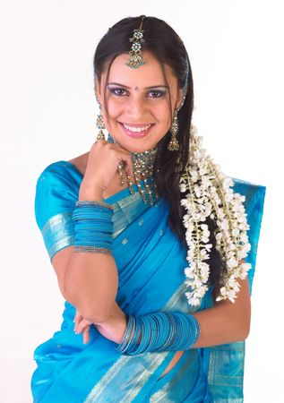 Beautiful hindu teenager dressd in a tradition blue silk sari
