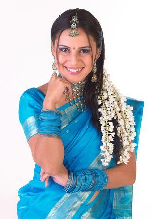 Beautiful hindu teenager dressd in a tradition blue silk sari