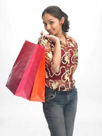 indian blue: Young girl with shopping bags Stock Photo