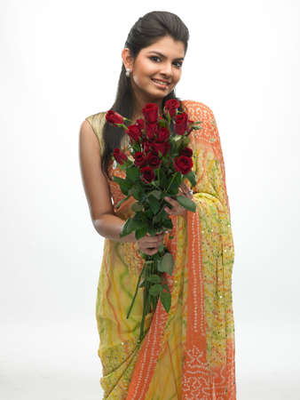 Laughing beautiful woman holding red roses photo