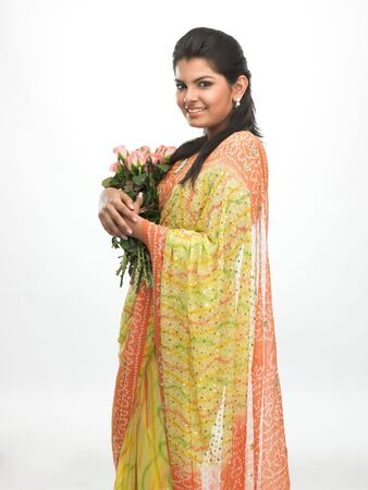 Asian woman in sari with bunch of pink roses photo