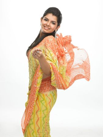 Indian woman in flying sari with happy expression