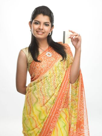 Modern asian girl in sari with the credit card photo