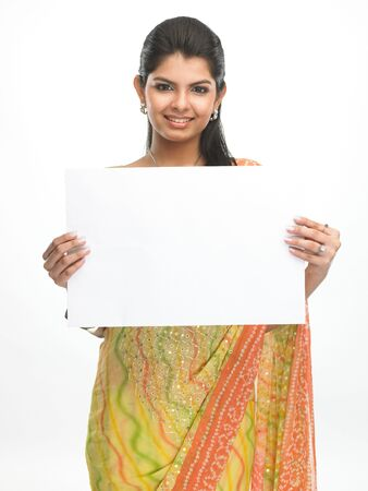 Indian woman in sari holding the white placard Stock Photo