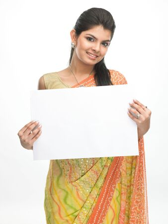Beautiful traditional asian girl with sari holding the white placard Stock Photo