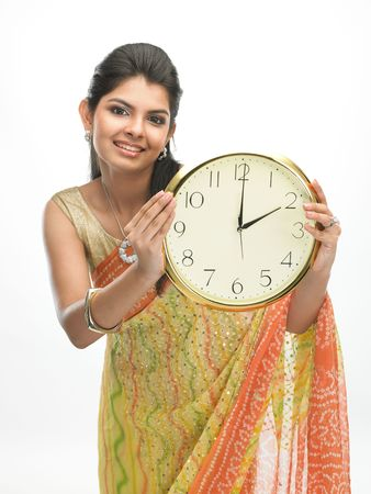 beautiful indian girl face: Beautiful smiling Asian woman holding big clock