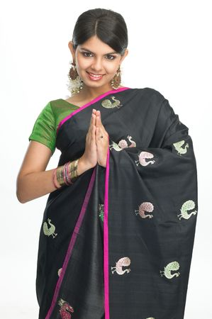 Asian girl with black silk-sari in welcome posture