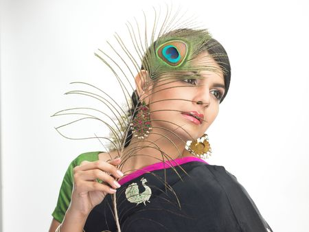 peacock feathers:  Teenage girl with peacock feathers Stock Photo