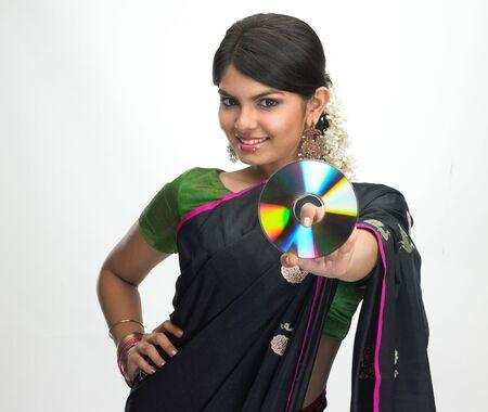 Asian girl in black sari with cd photo