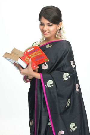 Asian young girl reading the book photo