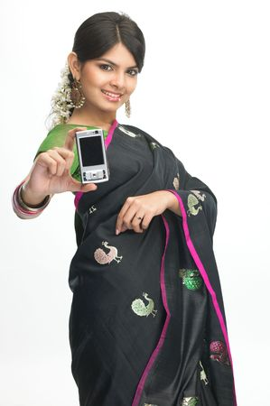 Indian girl in sari showing the mobile