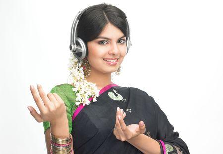 Asian girl with sari hearing music photo