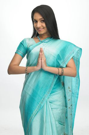 Asian girl in green sari with welcome expression