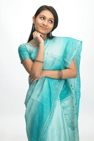 Young beautiful girl with sari in a standing posture photo