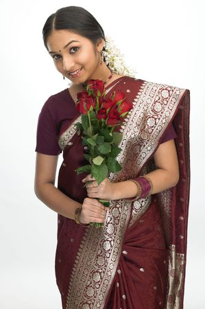 sari: Attractive indian girl with bunch of red roses