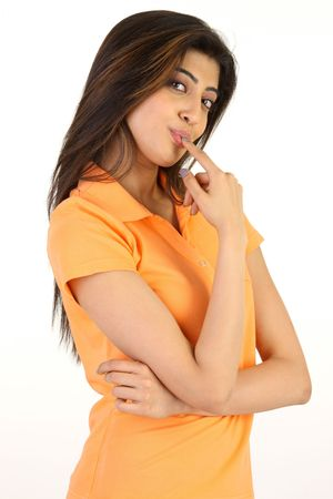 licking finger:  young girl licking her index finger Stock Photo