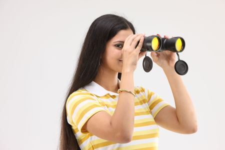 pretty girl looking in to the binocular Stock Photo - 4802812