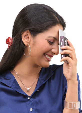 blushing: Happy smiling girl blushing with cell phone Stock Photo
