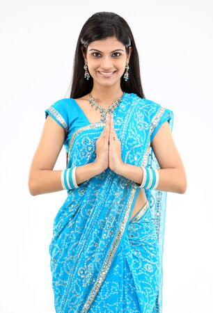 Smiling girl with greetings posture