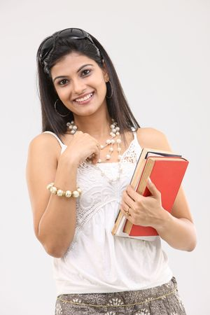 indian adult: glamorous girl with books