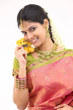 Woman in silk sari with cute small teddy photo