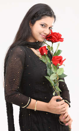 Teenage girl with artificial roses photo
