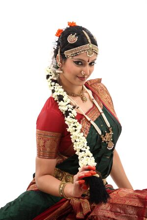 bharatanatyam dance:  Woman with beautiful hairstyle with lots of jasmine flowers