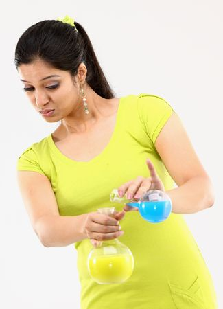 Girl with chemical mixing posture photo