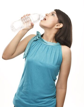 Indian teenage girl drinking water from a bottle