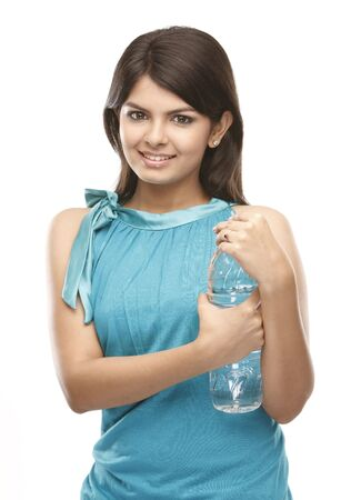 beautiful indian girl face:  teenage girl opening the water bottle Stock Photo