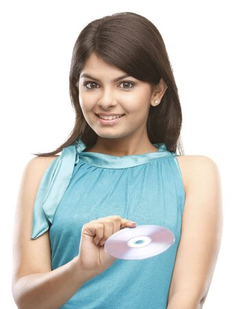 beautiful indian girl face:  asian beautiful woman holding a cd Stock Photo